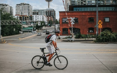lifestyle image of a person riding a bike through a part of downtown Seattle