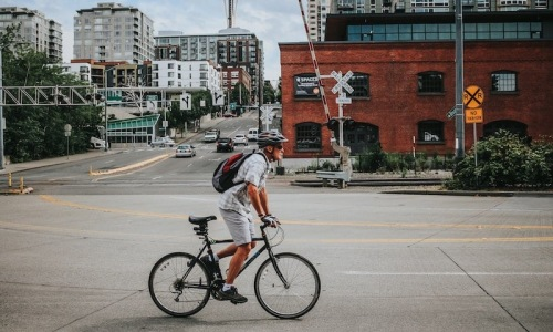 lifestyle image of a man on his bicycle